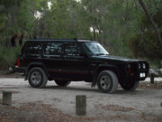 Jeep Cherokee XJ Sport 4WD 1995 with camping gear
